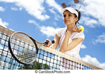 Young woman playing tennis, natural colorful tone