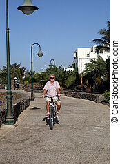 Senior Man On Cycle Ride