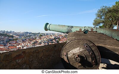 Cityscape of Lisbon in Portugal with cannon weapon - iron...