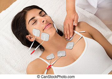 Woman Having Electrodes Therapy - Young Woman Lying With...
