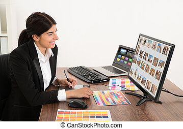 Female Graphic Designer In Office - Young Happy Female...