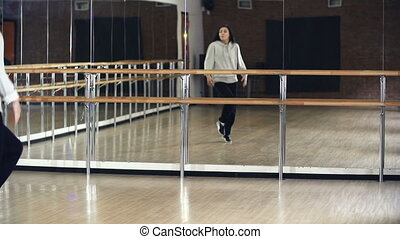 Dance Rehearsal - Close-up of young girl in casualwear...