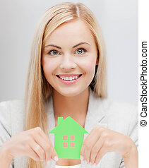 woman with illustration of eco house - smiling busineswoman...