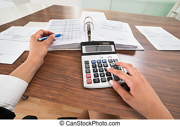 Businessperson Hands Calculating Bill - Close-up Of...