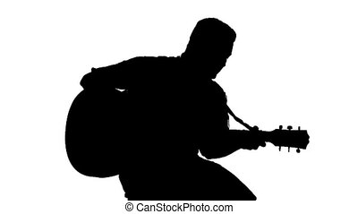 Black silhouette of guy playing guitar on a white background...