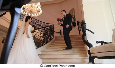 groom gives a bouquet to bride