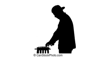 Black silhouette of a DJ playing a mixer on a white background