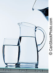 pitcher of water - water is poured into a carafe, symbolfoto...
