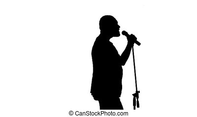 Black silhouette of a microphone and vigorously singing singer on a white background