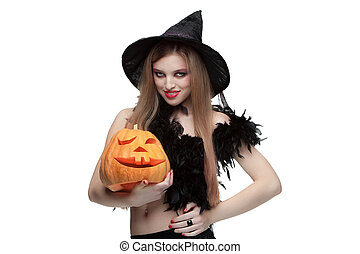 Girl in witch costume with Halloween pumpkin