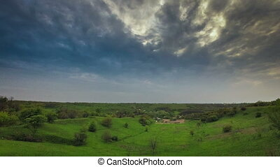 The sky before the storm - Blue stormy sky over a green...