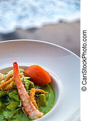 Ceviche close up - A beautiful ceviche with the ocean in the...