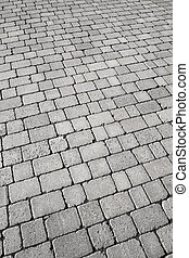 Black and white cobblestone street close up.