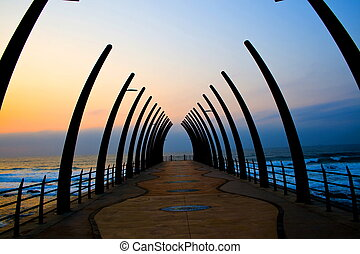 pier at sunrise, taken at Durban beach, South Africa