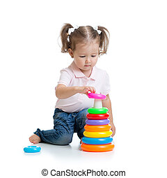 kid toddler playing with pyramid toy