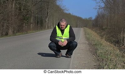 Tired runner with overweight drink from bottle on the...