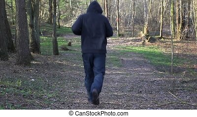 Man running away on the trail