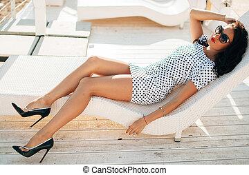 fashion luxury brunette lady model portrait on sunbed -...