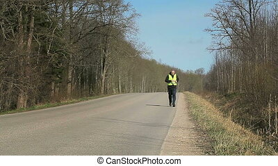 Man with overweight running on the highway
