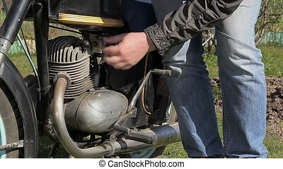 Man near old motorcycle at outdoor