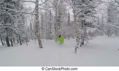 Snowboarder girl in powder snow - Snowboarder girl rides in...