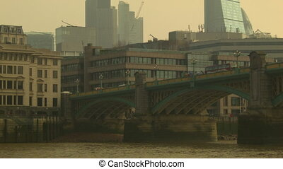 Pan on the Southwark Bridge at morning time, London Red bus...