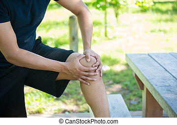 Knee joint pain outside - Closeup cropped portrait, man in...