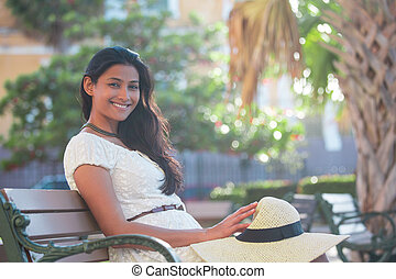Sophisticated woman chilling on bench - Closeup portrait...
