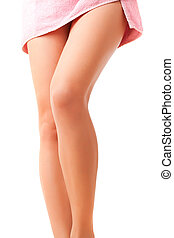Elegant woman\'s legs covered with a pink towel
