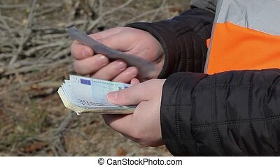 Man counting euro banknotes at outdoor