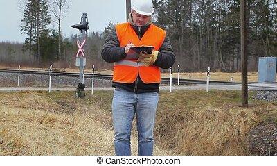 Railway employee with documents