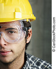 construction worker - Construction worker with goggles...