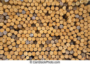 Stacked spars - Closeup of a woodpile with stacked, equal,...