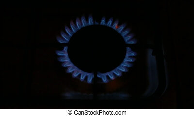 Gas burning top - A circle of burning gas flames from the...
