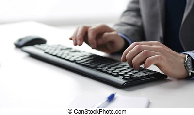 close up of businessman hands typing on keyboard - people,...