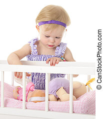 Feeding Baby Doll - An adorable 2-year-old feeding her baby...