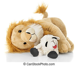 When Peace Reigns - A toy lamb and lion peacefully laying...