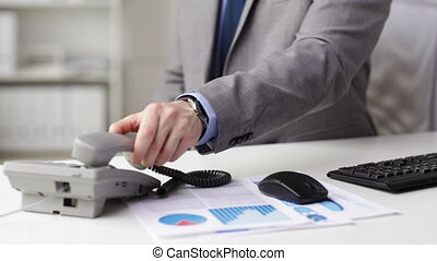 close up of businessman dialing phone number - people,...