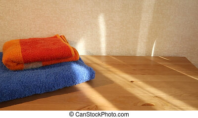 Blue and orange towels - Sliding view of blue and orange...