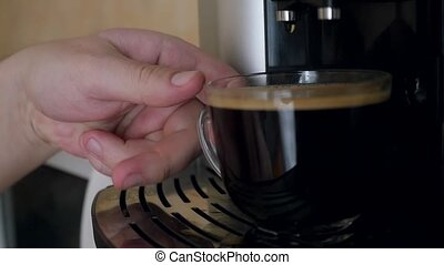 man takes a ready cup of coffee and drinks it with enjoy at...