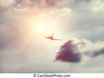 Airplane in the sky - Travel background, silhouette of an...