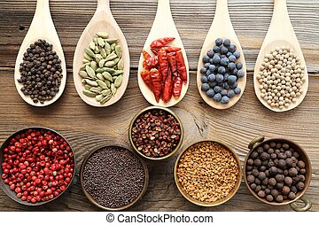 Spices and herbs in metal bowls and wooden spoons. Food and...