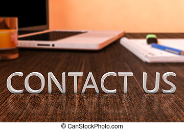 Contact us - letters on wooden desk with laptop computer and...