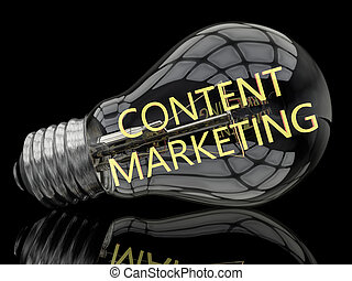 Content Marketing - lightbulb on black background with text...
