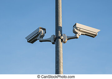 Two security cameras on a light post