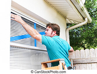 Man Taping His Windows