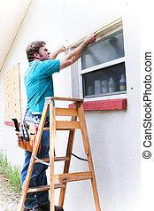 Contractor Measures Window