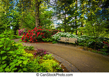Gardens and bench along a walkway at Pittock Acres Park in...