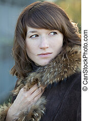 woman in fur coat - portrait of a woman in fur coat