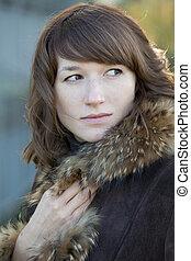 woman in fur coat
